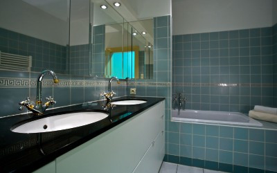 Blue Tile Bathroom with Bathtub