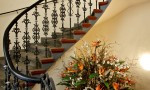 Staircase and Floral Arrangement
